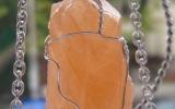 Orange calcite pendant wire wrapped in sterling silver