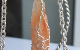 Tangerine calcite pendant wire wrapped in sterling silver