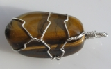 Tiger eye stone pendant wire wrapped in sterling silver