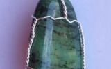 Zoisite pendant wire wrapped in sterling silver